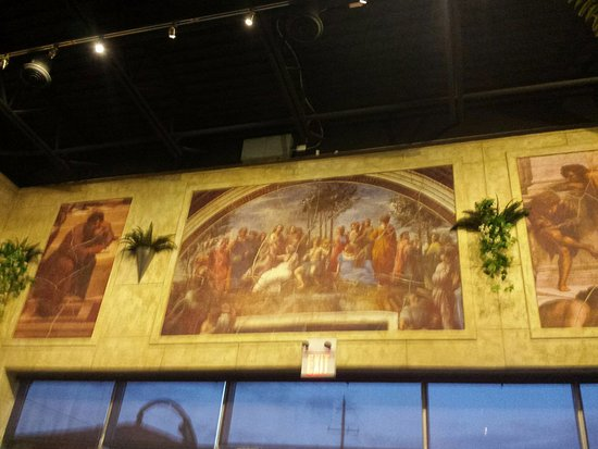 Artwork on the walls - Picture of Symposium Cafe Restaurant & Lounge ...