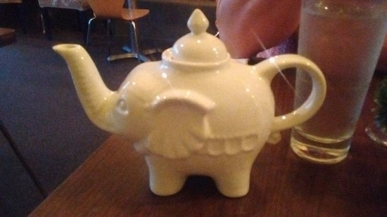 Littleton, NH: The darling teapot filled with hot Jasmine Tea
