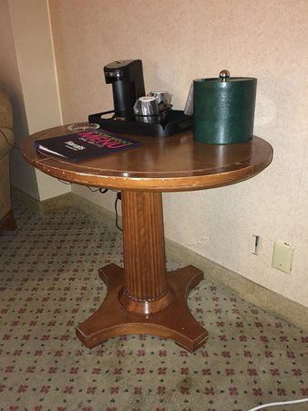 Harrah's Resort Atlantic City: The scratched table work space with no chair, hole in the wall, and dangling wall plate