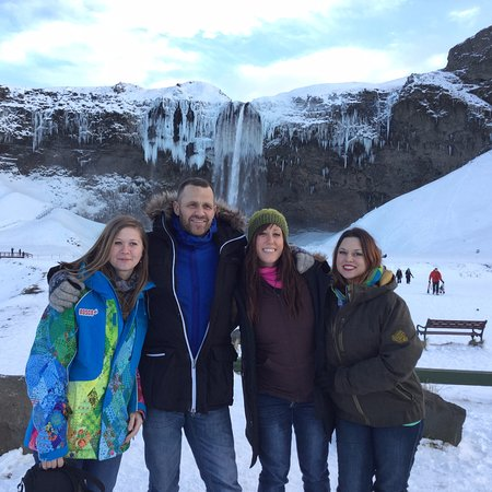 Kópavogur, Island: Good travel group enjoying life at Seljalandsfoss.