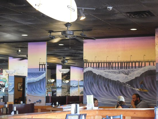 Dough Boy's California Pizza : Murals of the time surround you.