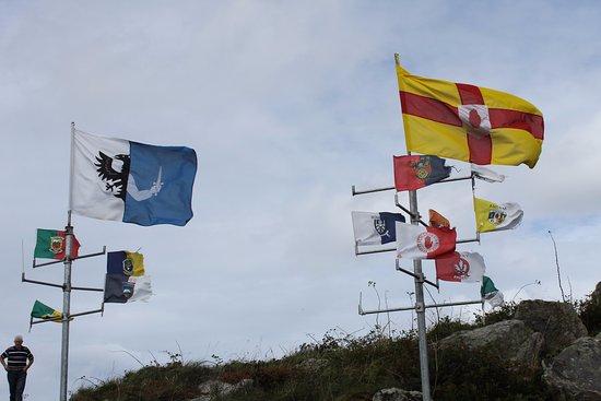 Flags at the Glencolmcille Folk Village parking lot