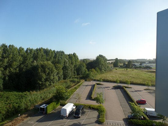 Ridderkerk, Nederland: View from a rear room. The trees conceal the highway....