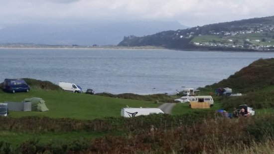 Llanbedr, UK: A small part of the campsite at Shell Island. Harlech castle in the background.