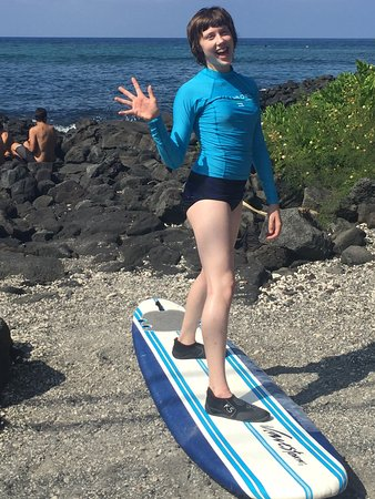 Kona Surf Company: Lessons started with on shore instructions. As you can see she is having a great time.
