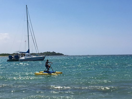 Ocean Sports Snorkel Adventure: My 10-year-old cruising in the Bay. Cataraman moored in the background.