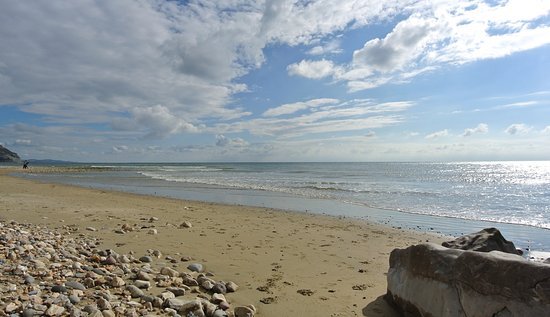 Charmouth, UK: A great place to sit on the rocks, or beach or wall and watch the world go by!