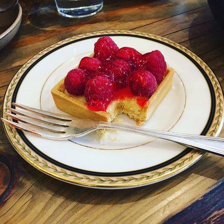 Lemon tart with raspberries and raspberry sauce.