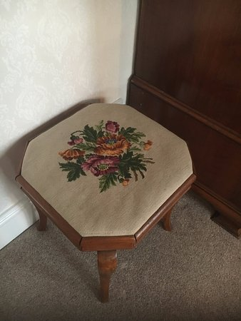 Wold Newton, UK: Needlepoint stool - one of the many antiques in the room