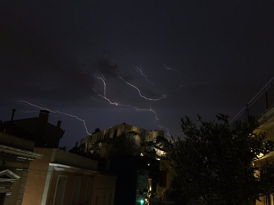AVA Hotel Athens: This was the view from our balcony (exclusive suite 301) during a lightning strike.