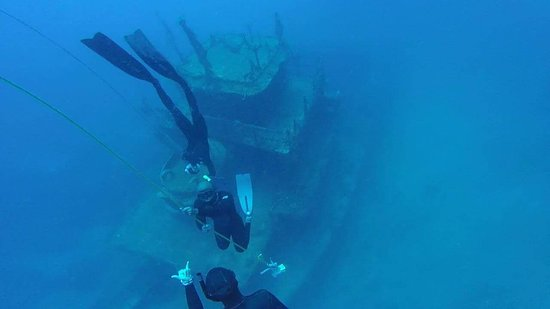 Above a shipwreck freediving 70ft underwater in Utila