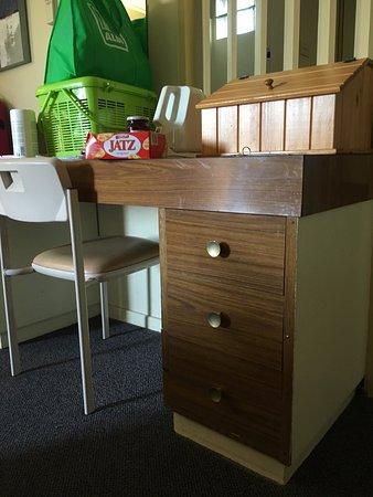 Lismore, Australia: Desk with edging tape falling off