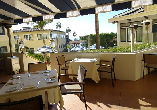 NINE-TEN Restaurant & Bar: Outdoor seating behind the restaurant and hotel