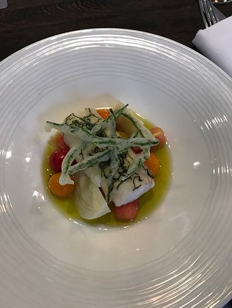 Langho, UK : Steamed hake with tomatoes