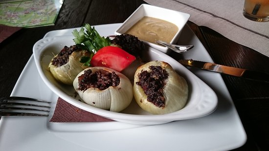 onions filled with black pudding with mustard on the side