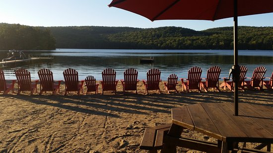Holderness, NH: Our Lake frontage directly across the road from our cottages and motel