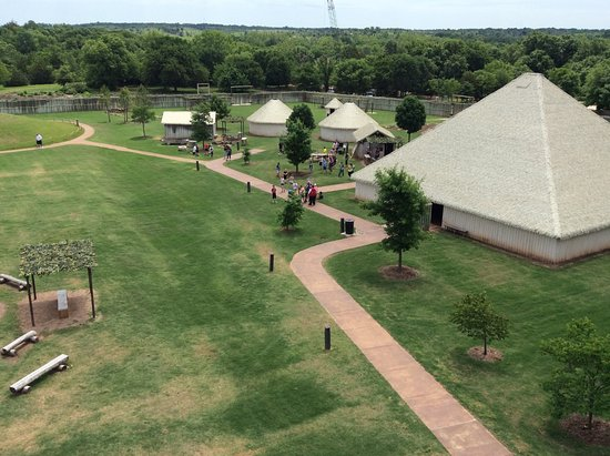 Chickasaw Cultural Center: Ancient Village, with cranes in the background building new bridge