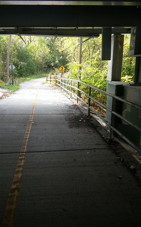 Lemont, IL: Trail going under a street. Notice the curves ahead sign as trail has alot of interest to it.