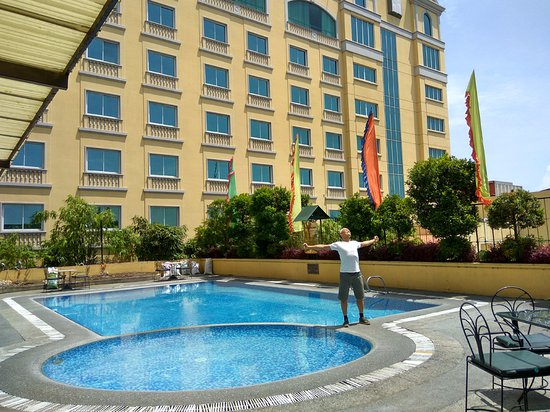The Royal Mandaya Hotel: outdoor pool on a hot sunny day at Royal Mandaya Hotel