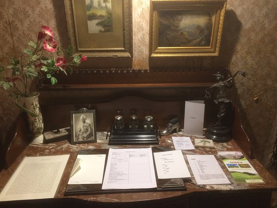 Chapslee: The writing desk, complete with ink set and family photos.