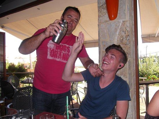 Kokalas Resort Georgioupoli: Nokos getting Aiden to sample his birthday cocktail. As you can tell NIKOS LOVES HIS JOB!! x x