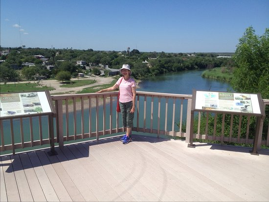 Roma, TX : View of the Rio Grande and Mexico, with posters about history and birds.