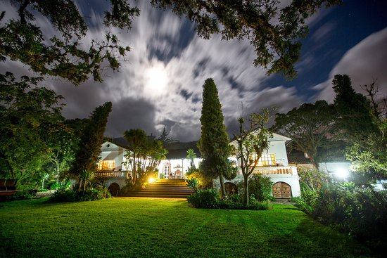 Hacienda Cusin: mainhouse in the moonlight, from central gardens