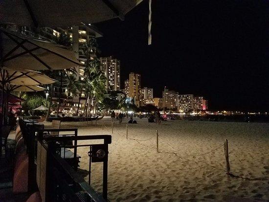 View Of Waikiki At Night From Our Table Picture Of Mai Tai Bar At Royal Hawaiian Hotel Oahu Tripadvisor