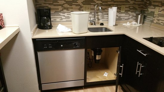 Staybridge Suites Stone Oak: Kitchen Cabinets Left Open Trash All Over  Countertop.