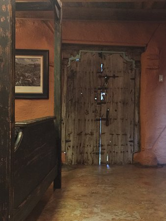 Trois Estate at Enchanted Rock: The door had large openings allowing small animals to enter and exit at their liesure