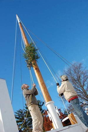 St Michaels, MD: A Chesapeake holiday tradition, hoisting a lit Christmas tree up a mast