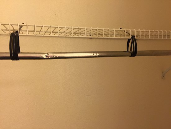 Mt. Whitney Motel: Closet Rod Is Tied Up With Plastic Cord And Black Mold