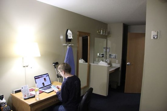 Super 8 by Wyndham Sioux Falls Shows the wide doorway sink and desk