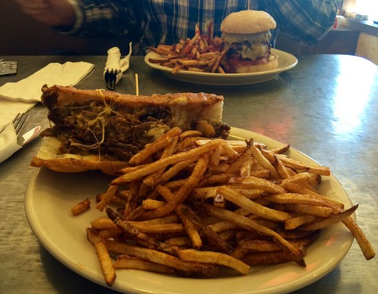 Víctor, ID: Steak and cheese, and Southern Pacific Cajun burger. Yum