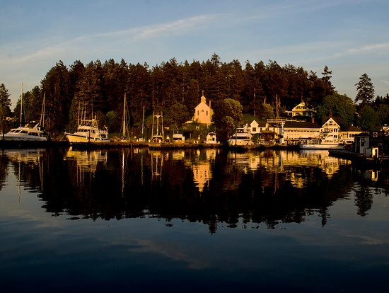 Roche Harbor Resort: View of the resort and church from the dock on a lovely evening with rosy sunset colors.