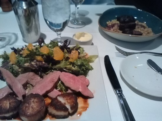 Owings Mills, MD: Right: Pan Seared Venison Front: scallops, duck and salad with citrus and hazelnuts