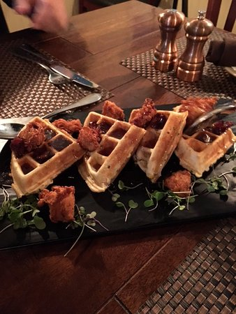 Pewaukee, Висконсин: MUST HAVE dish from Artisan 179: Waffles. Bacon. Maple syrup. Decadent.