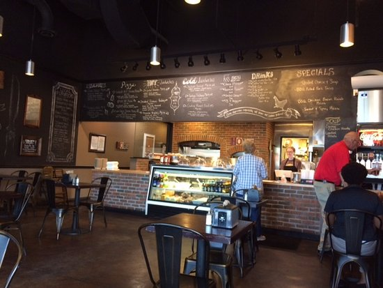 Home Cafe & Marketplace : Order upfront, menu listed above on chalk boards