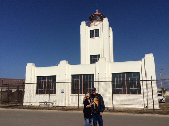 Port Hueneme, CA: Me and hubby in front of the lighthouse
