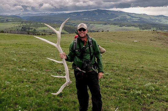 Livingston, MT: Chris, owner and lead guide for Yellowstone Guidelines, hiking in Yellowstone National Park