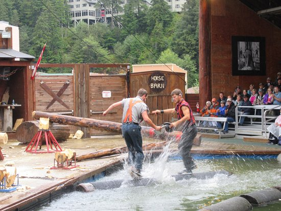Great Alaskan Lumberjack Show: rolling the logs in water to see who stays on
