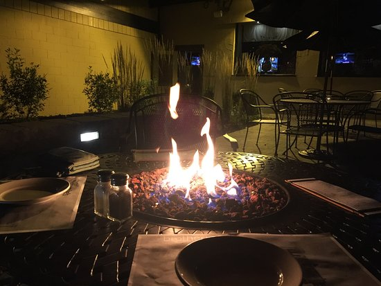 Madison, CT : Outdoor patio with a fire table.