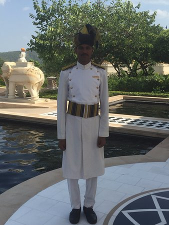 The Oberoi Udaivilas: this gorgeous man greets and waves goodbye as every day begins and ends with a beautiful smile