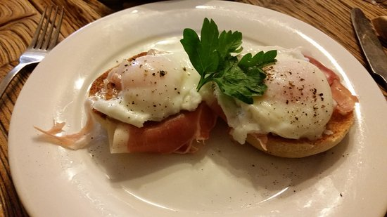 Honiton, UK: Poached eggs, on air dried ham, on a toasted muffin - Yum!