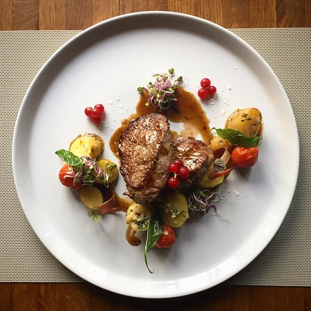 Ruse, Bulgaria: Veal medallions, baby potatoes and cherry tomatoes with wine sauce