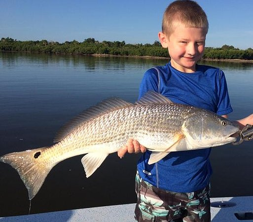 Young Cole with Edgewater Backcountry Redfish