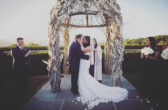 The Garrison - Golf, Restaurant, Events & Inn: Our first kiss as husband and wife in front of the spectacular pergola in the ceremony garden