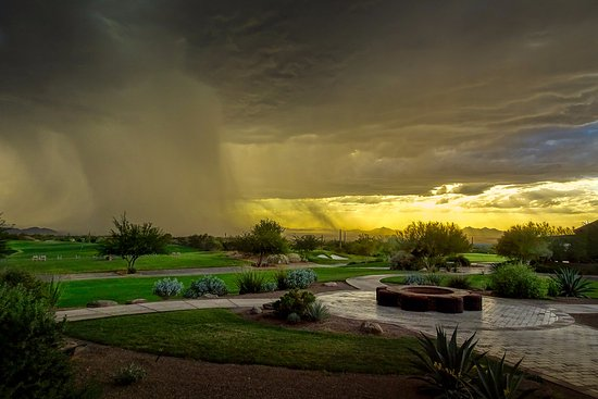 Marana, AZ: A storm cell approaches at sunset.
