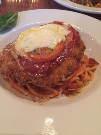 Freeport, ME: chicken parm with roscuito,cheese and a tomato on top and linguini