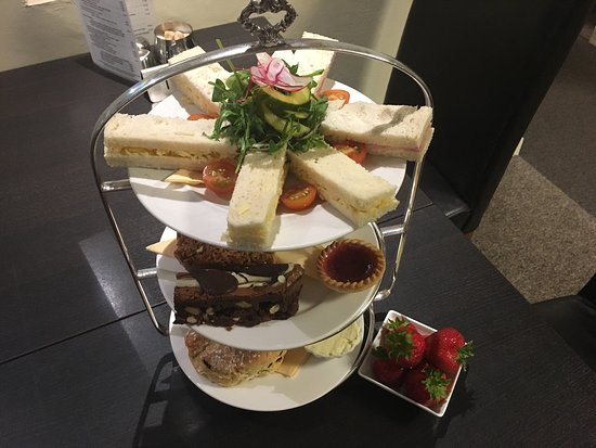 Shepton Mallet, UK: Afternoon tea - a selection of quality filled sandwiches, homemade cakes, fancies and biscuits